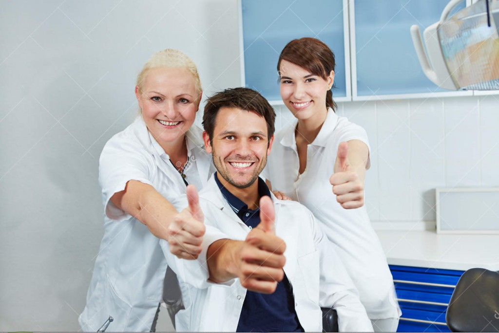 dentist-dental-team-holding-thumbs-up-happy-smiling-their-practice-33264746